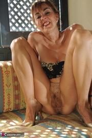 brunette milf gets naked