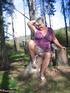 Engaging elderly platinum blonde in purple flowery dress celebrates her