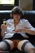 Horny brunette milf in white drinks her champagne before fingering her