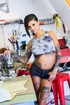Heavily tattooed brunette in blue top and shorts fucked in ass then sucks