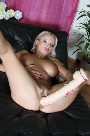 Sexy big lips blonde strips and masturbates with a huge dildo wearing extremely high heels - XXXonXXX - Pic 11