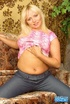 Smoking hot blonde in pink shirt and gray pants teases with her foxy body