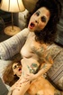 Naughty tattooed brunettes with zombie make up lick and finger pussies