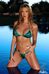 Red nailed blonde with big tits and pierced belly posing in green bikini