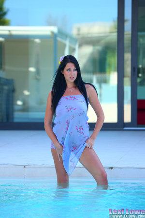 Black haired brunette slowly taking off her blue dress outdoors before fingering her itchy twat by the pool - XXXonXXX - Pic 9
