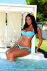 Busty brunette wiggles out of blue bikini in jacuzzi before toying her