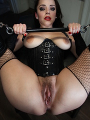 Fishnets-wearing domme in a corset fucking two - XXXonXXX - Pic 14