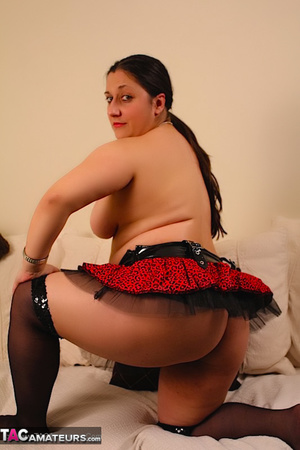 Cute BBW reveals her large breasts in red and black dress and black stockings then gets naked and expose her indulging twat as she opens her legs wide on a white couch. - XXXonXXX - Pic 15