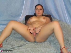 Hot BBW peels down her black and white thong and reveals her juicy pussy then takes off her black, brown and white corset and expose her large breasts in different poses wearing her red and clear high heels in a blue studio. - XXXonXXX - Pic 20