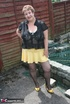 Steaming hot granny peels off her black blouse and yellow skirt and displays