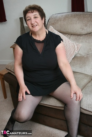 BBW granny peels off her black dress and displays her large body in red nighty, black skirt, stockings and high heels on a gray and brown couch. - XXXonXXX - Pic 4