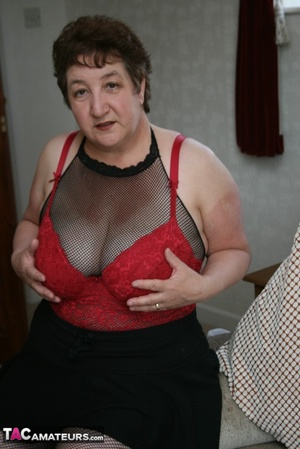 BBW granny peels off her black dress and displays her large body in red nighty, black skirt, stockings and high heels on a gray and brown couch. - XXXonXXX - Pic 15