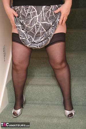Hot BBW peels off her black shirt and gray and white skirt then displays her large body in white lingerie, black stockings and silver high heels before she peels off her bra and reveals her humongous breasts then pulls down her panty and bares her ravishing pussy on a gray stairway. - XXXonXXX - Pic 5