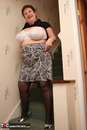 Hot BBW peels off her black shirt and gray and white skirt then displays her large body in white lingerie, black stockings and silver high heels before she peels off her bra and reveals her humongous breasts then pulls down her panty and bares her ravishing pussy on a gray stairway. - XXXonXXX - Pic 7