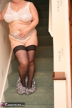 Hot BBW peels off her black shirt and gray and white skirt then displays her large body in white lingerie, black stockings and silver high heels before she peels off her bra and reveals her humongous breasts then pulls down her panty and bares her ravishing pussy on a gray stairway. - XXXonXXX - Pic 11