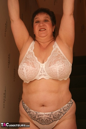 Hot BBW peels off her black shirt and gray and white skirt then displays her large body in white lingerie, black stockings and silver high heels before she peels off her bra and reveals her humongous breasts then pulls down her panty and bares her ravishing pussy on a gray stairway. - XXXonXXX - Pic 12
