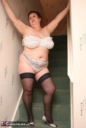 Hot BBW peels off her black shirt and gray and white skirt then displays her large body in white lingerie, black stockings and silver high heels before she peels off her bra and reveals her humongous breasts then pulls down her panty and bares her ravishing pussy on a gray stairway. - XXXonXXX - Pic 13