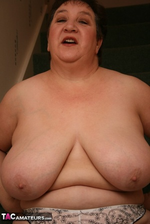 Hot BBW peels off her black shirt and gray and white skirt then displays her large body in white lingerie, black stockings and silver high heels before she peels off her bra and reveals her humongous breasts then pulls down her panty and bares her ravishing pussy on a gray stairway. - XXXonXXX - Pic 15