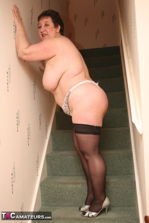 Hot BBW peels off her black shirt and gray and white skirt then displays her large body in white lingerie, black stockings and silver high heels before she peels off her bra and reveals her humongous breasts then pulls down her panty and bares her ravishing pussy on a gray stairway. - XXXonXXX - Pic 16