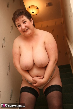 Hot BBW peels off her black shirt and gray and white skirt then displays her large body in white lingerie, black stockings and silver high heels before she peels off her bra and reveals her humongous breasts then pulls down her panty and bares her ravishing pussy on a gray stairway. - XXXonXXX - Pic 17