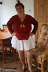 Chubby granny peels off her red blouse and white skirt and reveals her