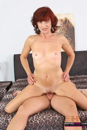 Mature redhead with small breast and blue eyes riding shaved pecker on the wide bed - XXXonXXX - Pic 6