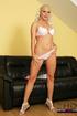 Blonde milf in high heels took off her white bra and exposing her big