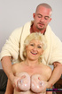 Big breasted granny with blond hair blowing younger bald dude on her knees