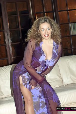 Curly hair milf with blue eyes and big naturals posing in sexy blue outfit and stockings - XXXonXXX - Pic 3