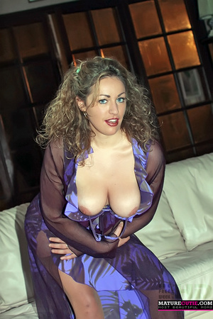 Curly hair milf with blue eyes and big naturals posing in sexy blue outfit and stockings - XXXonXXX - Pic 6