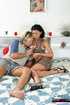 Black haired milf in tight outfit kissing with blond guy on the bed before