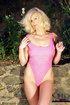 Big boobed blonde in pink outfit smoking and drinking beer outdoors before