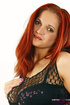 Busty redhead with pierced belly slowly taking off her fishnet peignoir