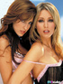 Luscious brunette in pink lingerie and an alluring blonde in black nighty