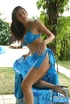 Big breasted brunette teasing outdoors in blue outfit before undressing