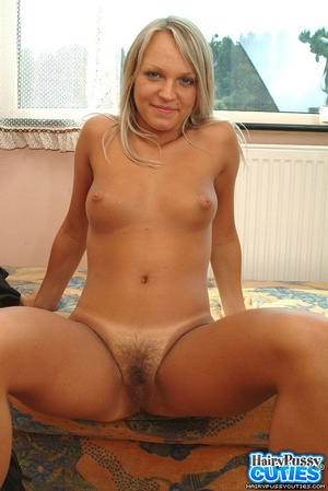 Big boobied blonde taking off her sexy lingerie on the sofa and then fingering her hairy fuck hole - XXXonXXX - Pic 3