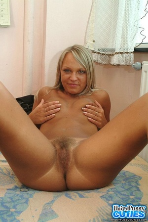 Big boobied blonde taking off her sexy lingerie on the sofa and then fingering her hairy fuck hole - XXXonXXX - Pic 5