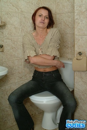 Redhead milf with bushy snatch taking off jeans and white undies before peeing in the toilet bowl - XXXonXXX - Pic 1