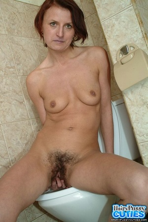 Redhead milf with bushy snatch taking off jeans and white undies before peeing in the toilet bowl - XXXonXXX - Pic 9