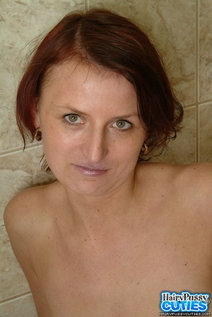 Redhead milf with bushy snatch taking off jeans and white undies before peeing in the toilet bowl - XXXonXXX - Pic 10