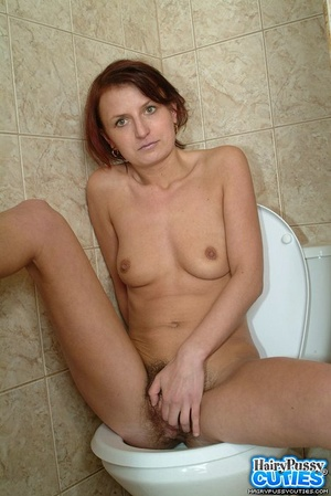 Redhead milf with bushy snatch taking off jeans and white undies before peeing in the toilet bowl - XXXonXXX - Pic 12
