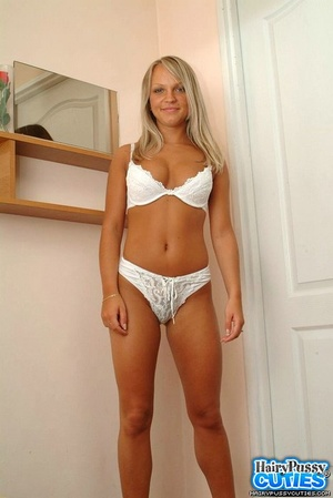 Busty blonde in pink skirt and white underwear stripteasing and opening her hairy pussy lips - XXXonXXX - Pic 7