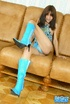 Skinny brunette in blue dress and boots sheds white panty and showing