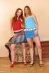 Redheads dressed in blue and red stretching before gape
