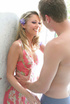 Gorgeous blonde displays her stunning body in pink, green and white dress