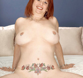 Tattooed redhead mama with big pierced tits ready to suck and screw young