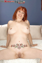 tattooed redhead mama with