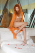 alluring redhead shows her