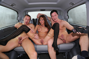 Brown haired slut with huge tits is wearing black stockings while having threesome in car - XXXonXXX - Pic 1