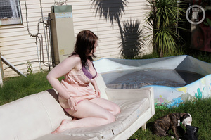 Steaming hot chick reveals her big boobs on a white couch then strips off her pink jacket, purple bra, pink panty and black boots and nails her sweet pussy with a blue dildo in different positions before she peels off her peach dress and gets her steaming hot body wet in a pool. - XXXonXXX - Pic 7